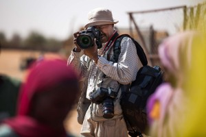 Reters photojournalist Mohamed Nureldin works in the Alabassi camp for Internally Displaced People (IDP), in Mellit, North Darfur. (Photo Credit: Albert Gonzalez Farran, UNAMID)