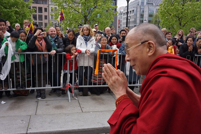 His Holiness the Dalai Lama acknowledging well-wishers in Oslo, Norway on May 9, 2014. (Photo Credit: Jeremy Russell/OHHDL)